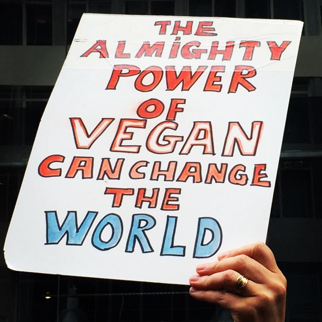 The almighty power of vegan can change the world placard at Animal Rebellion Protest, London